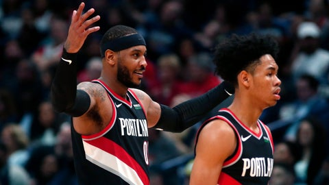 <p>               Portland Trail Blazers forward Carmelo Anthony, left, reacts as he walks to the bench with guard Anfernee Simons during the second half of the team's NBA basketball game against the New Orleans Pelicans in New Orleans, Tuesday, Nov. 19, 2019. The Pelicans won 115-104. (AP Photo/Gerald Herbert)             </p>