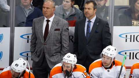 <p>               FILE - In this Oct. 29, 2019, file photo, Philadelphia Flyers assistant Michel Therrien, left, and head coach Alain Vigneault stand behind their bench during the first period of an NHL hockey game against the Pittsburgh Penguins, in Pittsburgh. Of 31 teams, 20 have a former NHL head coach as an assistant and six have more than one. Concerns about having too many cooks in the kitchen are blown away by the benefits of experience for how to deal with players, handle game situations and scout opponents. When Kevin Hayes got off to a slow start with the Philadelphia Flyers, coach Alain Vigneault didn't need to go talk to him. Assistants Mike Yeo and Michel Therrien took care of that. (AP Photo/Gene J. Puskar, File)             </p>