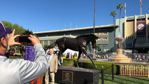 <p>               Fans pose for a picture in front of the Zenyatta statue at Santa Anita Park, Friday, Nov. 1, 2019, in Arcadia, Calif. It's the 10th anniversary of the superstar Mare's victory in the Breeders' Cup Classic. (AP Photo/Beth Harris)             </p>