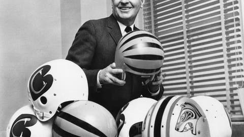 <p>               FILE - In this Jan. 3, 1968, file photo, Paul Brown, president of the New Cincinnati Bengals of the American Football League, is trying to select the design of helmets in Cincinnati, to be worn by his team when it starts play in the league. Brown, the innovative coach and powerful team owner who brought dozens of improvements to the sport, has been voted pro football's greatest game changer. (AP Photo/File)             </p>