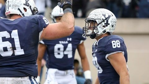 <p>               FILE - In this Nov. 18, 2017, file photo, Yale's JP Shohfi, right, celebrates with teammates after scoring a first half touchdown against Harvard during an NCAA college football game in New Haven, Conn. Yale quarterback Kurt Rawlings has rewritten the school's record books for passing, throwing the ball to Shohfi and Reed Klubnik, who he convinced to come with him to the Ivy League. (AP Photo/Gregory Payan, File)             </p>