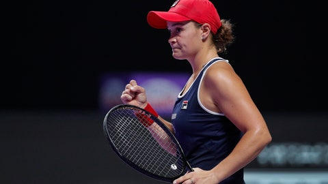 <p>               Ashleigh Barty of Australia celebrates after winning the first set against Elina Svitolina of Ukraine during the WTA Finals Tennis Tournament at the Shenzhen Bay Sports Center in Shenzhen, China's Guangdong province, Sunday, Nov. 3, 2019. (AP Photo/Andy Wong)             </p>