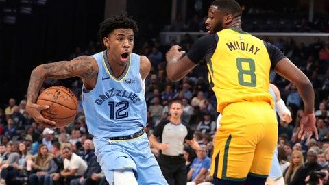 <p>               Memphis Grizzlies' Ja Morant (12) drives the ball around Utah Jazz's Emmanuel Mudiay (8)) during the first half of an NBA basketball game Friday, Nov. 15, 2019, in Memphis, Tenn. (AP Photo/Karen Pulfer Focht)             </p>