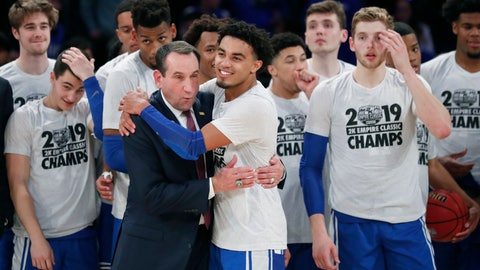 <p>               Duke guard Tre Jones (3) embraces coach Mike Krzyzewski after Duke defeated Georgetown 81-73 in an NCAA college basketball game in the 2K Empire Classic, Friday, Nov. 22, 2019 in New York. (AP Photo/Kathy Willens)             </p>