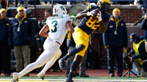 <p>               Michigan tight end Nick Eubanks (82) catches a 5-yard touchdown pass as Michigan State safety Xavier Henderson (3) defends in the first half of an NCAA college football game in Ann Arbor, Mich., Saturday, Nov. 16, 2019. (AP Photo/Paul Sancya)             </p>