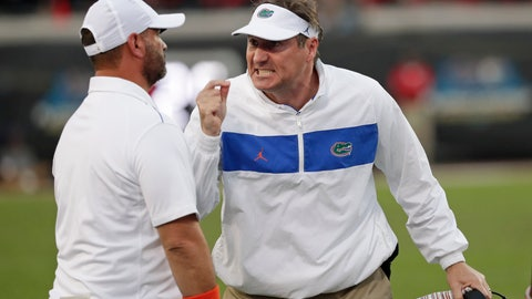 <p>               Florida head coach Dan Mullen, right, yells at receivers coach Billy Gonzales during the second half of an NCAA college football game against Georgia, Saturday, Nov. 2, 2019, in Jacksonville, Fla. (AP Photo/John Raoux)             </p>