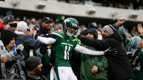 <p>               New York Jets wide receiver Robby Anderson (11) celebrates with fans after scoring a touchdown during the second half of an NFL football game against the Oakland Raiders Sunday, Nov. 24, 2019, in East Rutherford, N.J. The Jets won 34-3. (AP Photo/Adam Hunger)             </p>