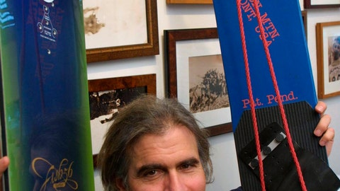 <p>               FILE - In this March 8, 2002, file photo, Jake Burton Carpenter, owner of Burton Snowboards, shows an early model, right, and one of the newer snowboards, left, in his office in Burlington, Vt. Carpenter, the innovator who brought the snowboard to the masses and helped turn the sport into a billion-dollar business, has died after a recurring bout with cancer. He was 65. Officials from the company he founded, Burton Snowboards, told The Associated Press of his death Thursday, Nov. 21, 2019. (AP Photo/Alden Pellett, File)             </p>