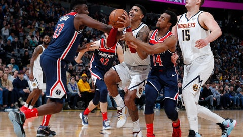 <p>               Denver Nuggets guard Gary Harris, second from left, is fouled as he drives the lane between Washington Wizards center Thomas Bryant, left, and guard Ish Smith, third from left, as Denver center Nikola Jokic looks on in the second half of an NBA basketball game Tuesday, Nov. 26, 2019, in Denver. The Nuggets won 117-104. (AP Photo/David Zalubowski)             </p>