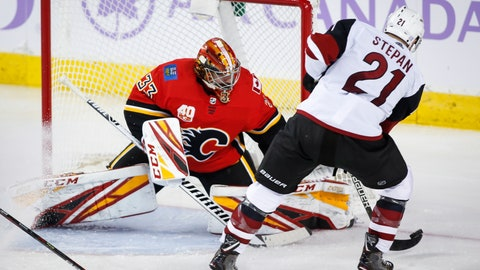 <p>               Arizona Coyotes' Derek Stepan, right, tries to get the puck past Calgary Flames goalie David Rittich during the third period of an NHL hockey game, Tuesday, Nov. 5, 2019 in Calgary, Alberta. (Jeff McIntosh/Canadian Press via AP)             </p>