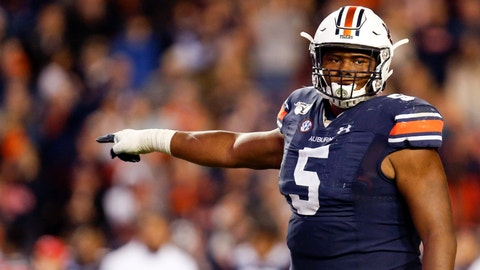 <p>               FILE - In this Saturday, Nov. 16, 2019, file photo, Auburn defensive tackle Derrick Brown (5) lines up against Georgia during the second half of an NCAA college football game in Auburn, Ala. Brown has been a play making, blockbusting force for No. 16 Auburn heading into the Iron Bowl. (AP Photo/Butch Dill, File)             </p>
