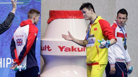 <p>               FILE - In this Tuesday, July 23, 2019 file photo, gold medalist China's Sun Yang gestures to Britain's bronze medalist Duncan Scott, left, following the medal ceremony in the men's 200m freestyle final at the World Swimming Championships in Gwangju, South Korea. One of China's biggest Olympic stars will undergo a rare public trial of a doping case on Friday, Nov. 15, 2019 with his 2020 Tokyo Games place at stake. Three-time gold medalist swimmer Sun Yang is facing a World Anti-Doping Agency appeal in Switzerland that seeks to ban him for up eight years. (AP Photo/Mark Schiefelbein, File)             </p>
