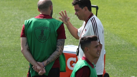 <p>               Coach Marcelo Gallardo, right, of Argentina's River Plate, talks to player Javier Pinola on the pitch at Alianza Lima's Club during a practice, in Lima, Peru, Thursday, Nov. 21, 2019. River Plate will play Brazil's Flamengo on Saturday, in the Copa Libertadores final match. (AP Photo/Martin Mejia)             </p>