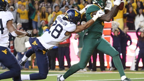 <p>               Baylor wide receiver Denzel Mims (5) catches a pass for a touchdown next to West Virginia cornerback Keith Washington Jr. (28) during the second half of an NCAA college football game in Waco, Texas, Thursday, Oct. 31, 2019. (AP Photo/Jerry Larson)             </p>
