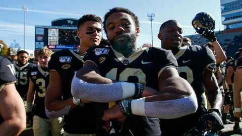 <p>               Wake Forest quarterback Jamie Newman, center, stands on the field after leading his team to a 44-10 win over North Carolina State in NCAA college football game in Winston-Salem, N.C., Saturday, Nov. 2, 2019. (AP Photo/Nell Redmond)             </p>