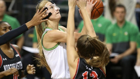 <p>               Oregon's Lydia Giomi, center, shoots between Northeastern's Mine Oriyomi, left, and Katie May during the fourth quarter of an NCAA college basketball game in Eugene, Ore., Monday, Nov. 11, 2019. (AP Photo/Chris Pietsch)             </p>
