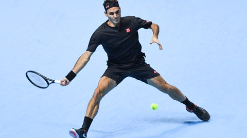 <p>               Roger Federer of Switzerland returns to Novak Djokovic of Serbia during their ATP World Tour Finals singles tennis match at the O2 Arena in London, Thursday, Nov. 14, 2019. (AP Photo/Alberto Pezzali)             </p>