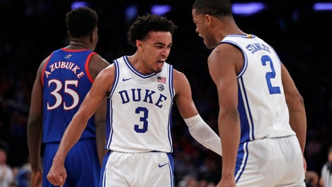 <p>               Duke guard Tre Jones (3) and guard Cassius Stanley (2) react after a basket during the second half of the team's NCAA college basketball game against Kansas on Tuesday, Nov. 5, 2019, in New York. (AP Photo/Adam Hunger)             </p>
