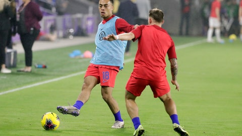 <p>               U.S. defender Sergino Dest warms up with teammates before a CONCACAF Nations League soccer match against Canada Friday, Nov. 15, 2019, in Orlando, Fla. (AP Photo/John Raoux)             </p>