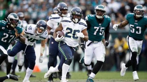 <p>               Seattle Seahawks' Rashaad Penny (20) runs for a touchdown during the second half of an NFL football game against the Philadelphia Eagles, Sunday, Nov. 24, 2019, in Philadelphia. (AP Photo/Matt Rourke)             </p>