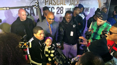 <p>               Boxer Gervonta Davis sits with his daughter as he speaks with the media at boxing news conference, Tuesday, Nov. 26, 2019, in Atlanta. Eager to take his career to a higher level, Davis will move up to fight Cuba's Yuriorkis Gamboa for the WBA's secondary lightweight title.  (AP Photo/Paul Newberry)             </p>