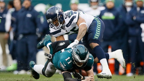 <p>               Philadelphia Eagles' Carson Wentz (11) is tackled by Seattle Seahawks' Mychal Kendricks (56) during the second half of an NFL football game, Sunday, Nov. 24, 2019, in Philadelphia. (AP Photo/Michael Perez)             </p>
