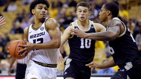 <p>               Missouri's Mark Smith, left, heads to the basket as Wofford's Nathan Hoover (10) and Messiah Jones defend during the second half of an NCAA college basketball game Monday, Nov. 18, 2019, in Columbia, Mo. (AP Photo/Jeff Roberson)             </p>