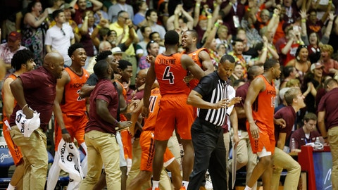 <p>               The Virginia Tech bench and fans react after defeating Michigan State at an NCAA college basketball game Monday, Nov. 25, 2019, in Lahaina, Hawaii. (AP Photo/Marco Garcia)             </p>