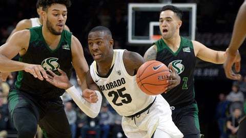 <p>               Colorado guard McKinley Wright IV (25) drives between Sacramento State's guards Ethan Esposito, left, and Izayah Mauriohooho-Le'Afa, back right, in the first half of an NCAA college basketball game, Saturday, Nov. 30, 2019, in Boulder, Colo. (AP Photo/Cliff Grassmick)             </p>