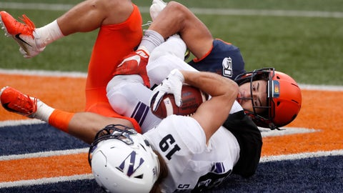<p>               Northwestern wide receiver Riley Lees (19) catches a touchdown pass as Illinois defensive back Sydney Brown (30) defends during the second half of an NCAA college football game Saturday, Nov. 30, 2019, in Champaign , Ill. Northwestern won 29-10. (AP Photo/Charles Rex Arbogast)             </p>