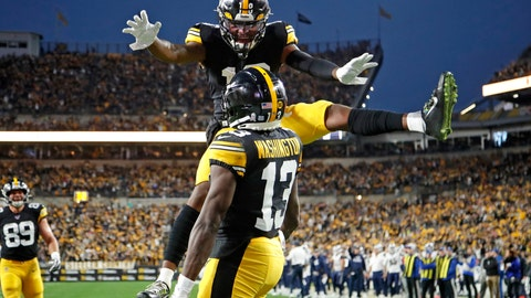 <p>               Pittsburgh Steelers wide receiver James Washington (13) celebrates his touchdown catch with Diontae Johnson (18) during the first half of an NFL football game against the LoLos Angeles Rams in Pittsburgh, Sunday, Nov. 10, 2019. (AP Photo/Don Wright)             </p>