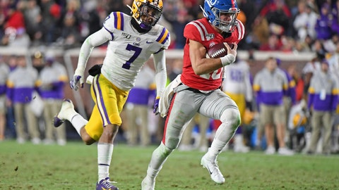<p>               Mississippi quarterback John Rhys Plumlee (10) carries the ball past LSU safety Grant Delpit (7) during the second half of an NCAA college football game in Oxford, Miss., Saturday, Nov. 16, 2019. LSU won 58-37. (AP Photo/Thomas Graning)             </p>