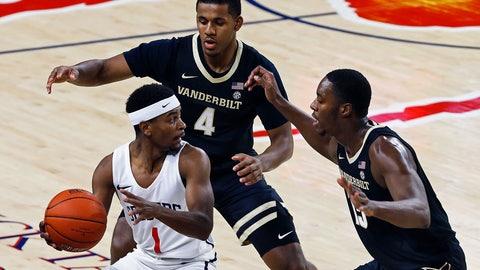 <p>               Richmond's Blake Francis (1) works the ball around Vanderbilt's Jordan Wright (4) and Clevon Brown (15) during the first half of an NCAA college basketball game Thursday, Nov. 14, 2019, in Richmond, Va. (Mark Gormus/Richmond Times-Dispatch via AP)             </p>