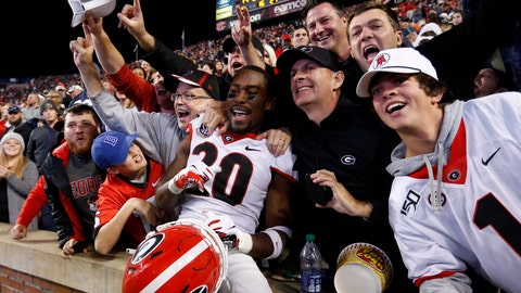 <p>               Georgia defensive back J.R. Reed (20) celebrates with fans after the team defeated Auburn 21-14 in an NCAA college football game, Saturday, Nov. 16, 2019, in Auburn, Ala. (AP Photo/Butch Dill)             </p>