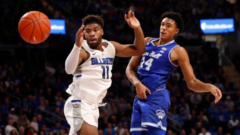 <p>               Seton Hall's Jared Rhoden (14) passes around Saint Louis' Hasahn French (11) during the first half of an NCAA college basketball game Sunday, Nov. 17, 2019, in St. Louis. (AP Photo/Jeff Roberson)             </p>