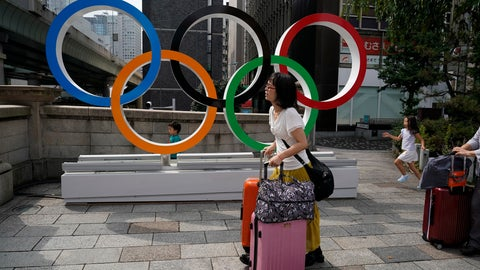 <p>               FILE - In this Aug. 19, 2019, file photo, tourists walk with their luggage past the Olympic rings in Tokyo. Frustrated residents of Japan got another shot at attending next year's Tokyo Olympics when organizers on Friday, Nov. 8, 2019, put about 1 million more tickets into the latest lottery. (AP Photo/Jae C. Hong, File)             </p>