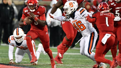 <p>               Louisville quarterback Micale Cunningham (3) runs from the attempted tackle of Syracuse linebacker Lakiem Williams (46) during the first half of an NCAA college football game in Louisville, Ky., Saturday, Nov. 23, 2019. (AP Photo/Timothy D. Easley)             </p>