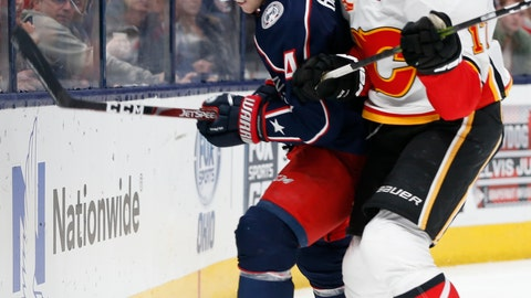<p>               Columbus Blue Jackets' Scott Harrington, left, fights off a check from Calgary Flames' Milan Lucic during the first period of an NHL hockey game Saturday, Nov. 2, 2019, in Columbus, Ohio. (AP Photo/Jay LaPrete)             </p>