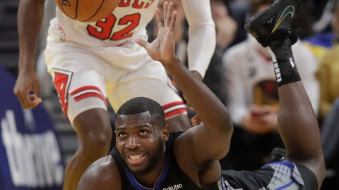 <p>               Golden State Warriors forward Eric Paschall (7) dives for the ball in front of Chicago Bulls guard Kris Dunn (32) during the first half of an NBA basketball game in San Francisco, Wednesday, Nov. 27, 2019. (AP Photo/Jeff Chiu)             </p>