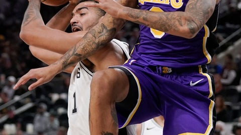 <p>               Los Angeles Lakers' Kyle Kuzma, right, collides with San Antonio Spurs' Trey Lyles during the first half of an NBA basketball game, Sunday, Nov. 3, 2019, in San Antonio. (AP Photo/Darren Abate)             </p>