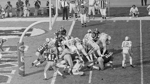 <p>               FILE - In this Jan. 14, 1973 file photo, Miami Dolphins' Jim Kiick (21) follows teammates Jim Langer (62) and Larry Csonka (39) to score against the Washington Redskins during Super Bowl VII in Los Angeles. The perfection of the 1972 Miami Dolphins has earned them the nod as the NFL's greatest team. The 1972 Dolphins edged the 1985 Chicago Bears for the NFL's greatest team in balloting by 59 national media members as part of the NFL's celebration of its 100th season. (AP Photo)             </p>