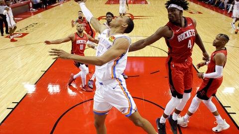 <p>               Oklahoma City Thunder forward Darius Bazley, center, shoots as Houston Rockets forward Danuel House Jr. (4) defends during the second half of an NBA basketball game, Monday, Oct. 28, 2019, in Houston. (AP Photo/Eric Christian Smith)             </p>
