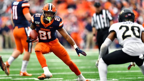 <p>               Syracuse running back Moe Neal, left, tries to elude Wake Forest defensive back Coby Davis (20) during the first half of an NCAA college football game in Syracuse, N.Y., Saturday, Nov. 30, 2019. (AP Photo/Adrian Kraus)             </p>