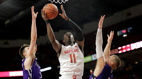 <p>               Maryland guard Darryl Morsell (11) goes up for a shot against Holy Cross forward Connor Niego, left, and guard Austin Butler during the first half of an NCAA college basketball game, Tuesday, Nov. 5, 2019, in College Park, Md. (AP Photo/Julio Cortez)             </p>