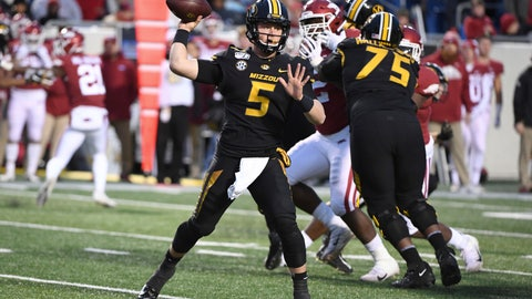 <p>               Missouri quarterback Taylor Powell drops back to pass against Arkansas during the second half of an NCAA college football game Friday, Nov. 29, 2019, in Little Rock, Ark. (AP Photo/Michael Woods)             </p>