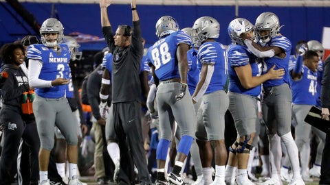 <p>               Memphis coach Mike Norvell celebrates along with players on the sideline late in the fourth quarter of the team's NCAA college football game against SMU on Saturday, Nov. 2, 2019, in Memphis, Tenn. Memphis won 54-48. (AP Photo/Mark Humphrey)             </p>