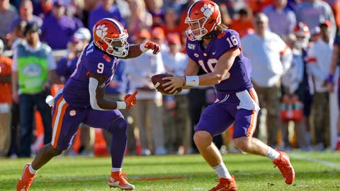 <p>               Clemson quarterback Trevor Lawrence (16) hands the ball off to running back Travis Etienne (9) during the first half of an NCAA college football game against Wofford, Saturday, Nov. 2, 2019, in Clemson, S.C. (AP Photo/Richard Shiro)             </p>