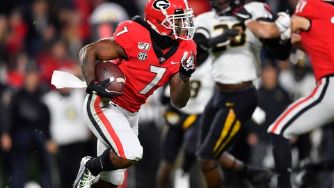 <p>               Georgia running back D'Andre Swift (7) rushes during the first half of an NCAA college football game against Missouri, Saturday, Nov. 9, 2019, in Athens, Ga. (AP Photo/John Amis)             </p>