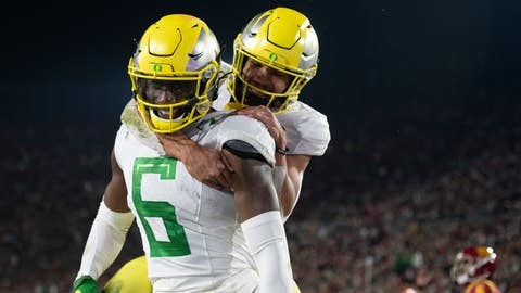 <p>               Oregon wide receiver Juwan Johnson, left, celebrates his touchdown with running back Travis Dye during the second half of an NCAA college football game against Southern California, Saturday, Nov. 2, 2019, in Los Angeles. (AP Photo/Kyusung Gong)             </p>