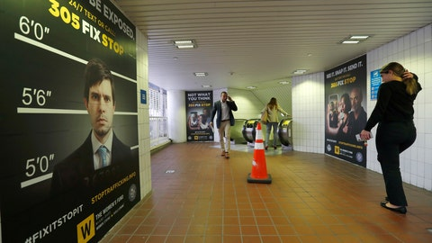 <p>               Pedestrians pass large posters aimed at curbing sex trafficking, Wednesday, Nov. 6, 2019, at the Metromover Knight Center Station in Miami. Authorities in Miami are launching the initiative in the events surrounding February's Super Bowl. (AP Photo/Wilfredo Lee)             </p>